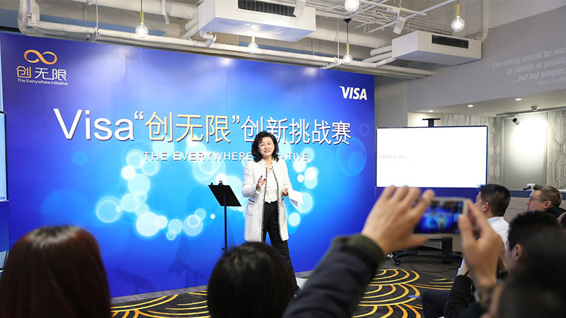 Woman gives speech at China's Visa Everywhere Initiative competition.